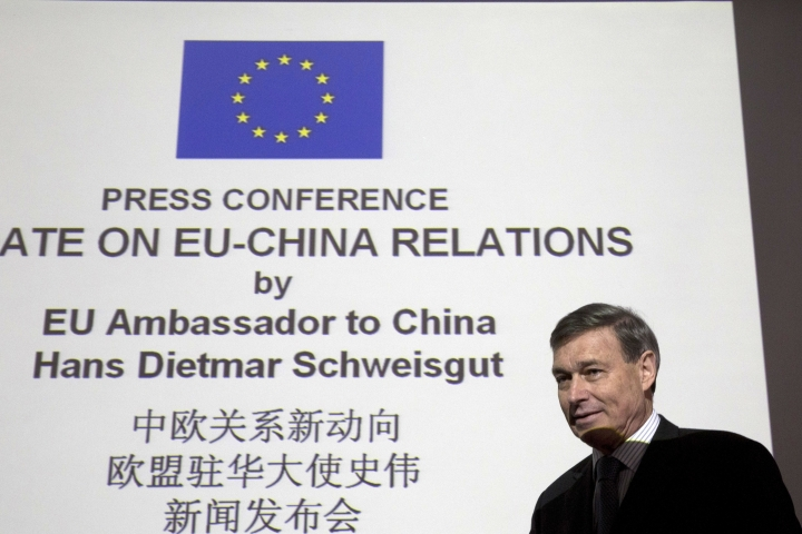European Union ambassador to China Hans Dietmar Schweisgut arrives for a press conference in Beijing, China, Wednesday, Jan. 25, 2017. The European Union ambassador to China has welcomed its endorsement of free trade in the face of U.S. President Donald Trump's promise to restrict imports and appealed to Beijing to lower its own market barriers. (AP Photo/Ng Han Guan)