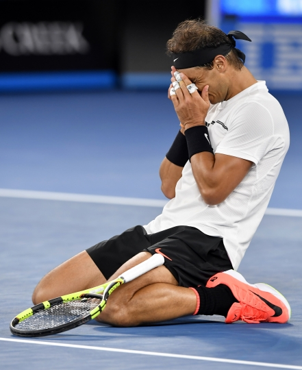 Spain's Rafael Nadal celebrates after defeating Canada's Milos Raonic during their quarterfinal at the Australian Open tennis championships in Melbourne, Australia, Wednesday, Jan. 25, 2017. (AP Photo/Andy Brownbill)