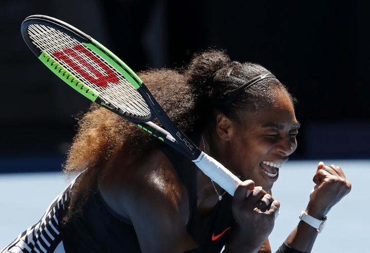 United States' Serena Williams celebrates her win over Britain's Johanna Konta during their quarterfinal at the Australian Open tennis championships in Melbourne, Australia, Wednesday, Jan. 25, 2017. (AP Photo/Dita Alangkara)