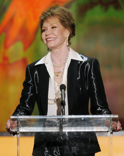 FILE - This Jan 29, 2012 file photo shows Mary Tyler Moore accepting the Life Achievement award at the 18th Annual Screen Actors Guild Awards in Los Angeles. Moore died Wednesday, Jan. 25, 2017, at age 80. (AP Photo/Mark J. Terrill, File)