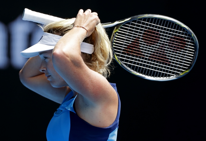 United States' Coco Vandeweghe adjusts her hair while playing her compatriot Venus Williams during their semifinal at the Australian Open tennis championships in Melbourne, Australia, Thursday, Jan. 26, 2017. (AP Photo/Dita Alangkara)