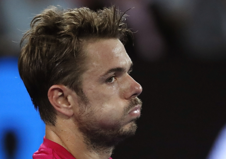 Switzerland's Stan Wawrinka reacts while playing compatriot Roger Federer during their semifinal at the Australian Open tennis championships in Melbourne, Australia, Thursday, Jan. 26, 2017. (AP Photo/Kin Cheung)