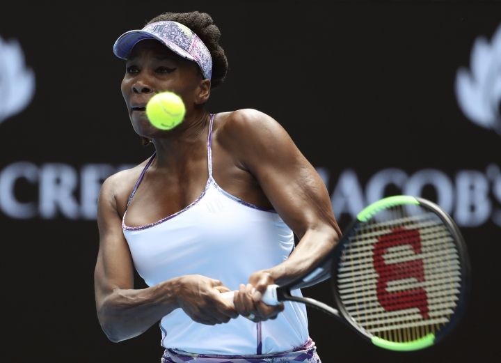 United States' Venus Williams makes a backhand return to compatriot Coco Vandeweghe during their semifinal at the Australian Open tennis championships in Melbourne, Australia, Thursday, Jan. 26, 2017. (AP Photo/Aaron Favila)