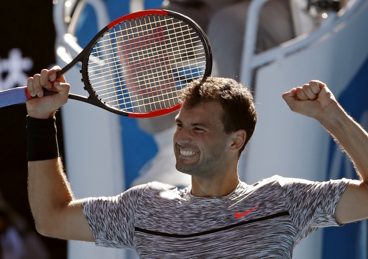 Bulgaria's Grigor Dimitrov celebrates after defeating Belgium's David Goffin during their quarterfinal at the Australian Open tennis championships in Melbourne, Australia, Wednesday, Jan. 25, 2017. (AP Photo/Dita Alangkara)