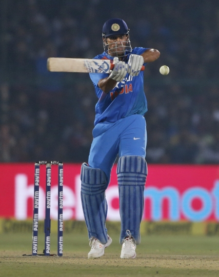 India's MS Dhoni plays a shot during their first Twenty20 cricket match against England at Green Park stadium in Kanpur, India, Thursday, Jan. 26, 2017. (AP Photo/Altaf Qadri)