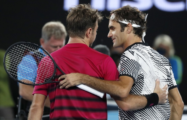 Switzerland's Roger Federer, right, is congratulated by compatriot Stan Wawrinka, after winning their semifinal at the Australian Open tennis championships in Melbourne, Australia, Thursday, Jan. 26, 2017. (AP Photo/Kin Cheung)