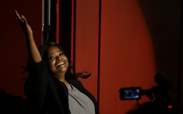 Actress Octavia Spencer acknowledges the applause of fans as she enters Farkas Hall for the presentation of the Hasty Pudding Theatricals annual Woman of the Year Pudding Pot Award Thursday, Jan. 26, 2017, in Cambridge, Mass. (AP Photo/Stephan Savoia)