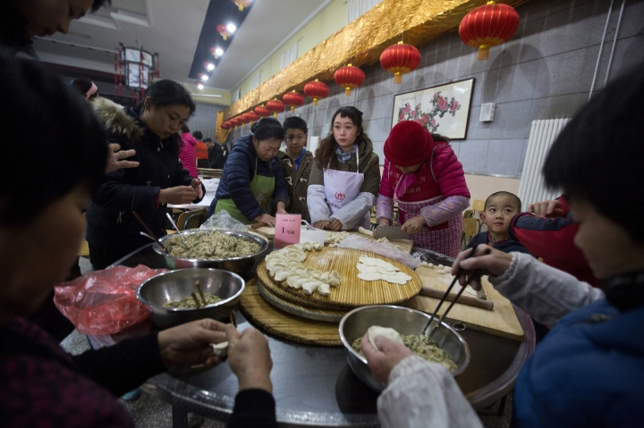 Villagers gather to make dumplings ahead of the lunar Chinese new year at a village on the outskirts of Beijing, China, Thursday, Jan. 26, 2017. Chinese in mainland China hand make and eat dumplings to mark the start of the Year of the Rooster on Jan 28, 2017. (AP Photo/Ng Han Guan)