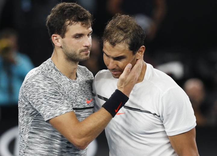Spain's Rafael Nadal, right, is congratulated by Bulgaria's Grigor Dimitrov after winning their semifinal at the Australian Open tennis championships in Melbourne, Australia, Saturday, Jan. 28, 2017. (AP Photo/Kin Cheung)