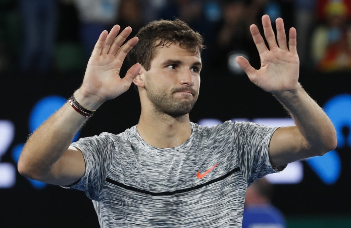 Bulgaria's Grigor Dimitrov waves as he leaves Rod Laver Arena after losing to Spain's Rafael Nadal in their semifinal at the Australian Open tennis championships in Melbourne, Australia, Saturday, Jan. 28, 2017. (AP Photo/Kin Cheung )