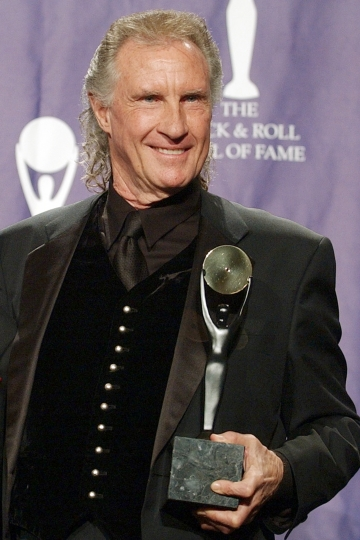 FILE - in this March 10, 2003 file photo, Bill Medley, one half of the famed Righteous Brothers signing duo, poses for photographers after being inducted into the Rock and Roll Hall of Fame in New York City. Los Angeles County authorities said Friday, Jan. 27, 2017, they've solved the 1976 rape and killing of Medley's ex-wife, Karen Klass. Investigators said they've identified a suspect by using DNA from a relative of the suspect. (AP Photo/Ed Betz, File)