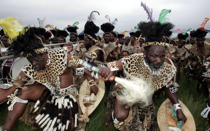FILE - In this Jan. 15, 2016 file photo members of the Shembe Church dressed in tribal leopard skins sing the praise of their prophet on the holy Nlangakazi Mountain north of Durban, South Africa in an annual pilgrimage. In a gathering this weekend many worshippers will wear leopard skins, seen as symbols of status and power. Some of the pelts to be displayed, however, are fake, reflecting an effort by an international conservation group to reduce poaching of Africa's threatened leopards. (AP Photo/Themba Hadebe, File)