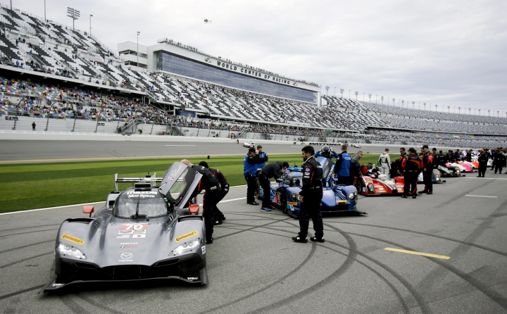 Cars line pit road before the start of the IMSA 24-hour auto race at Daytona International Speedway, Saturday, Jan. 28, 2017, in Daytona Beach, Fla. (AP Photo/John Raoux)