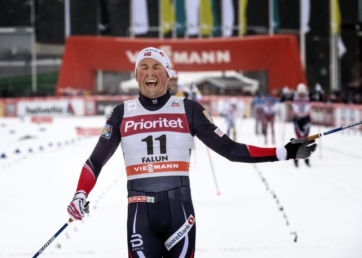 Norway's Emil Iversen celebrates as he crosses the finish line to win the mens 30km mass start event at the FIS Cross Country World Cup in Falun, Sweden, Sunday, Jan. 29, 2017. (Ulf Palm /TT via AP)