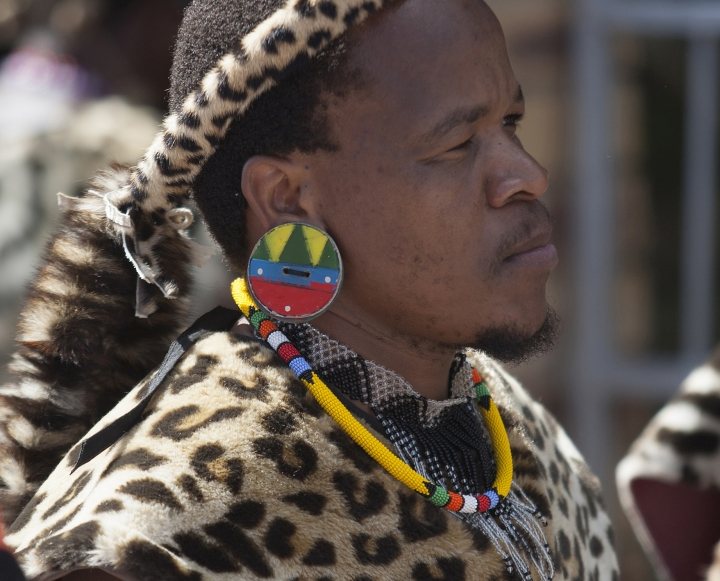 A members of the Shembe Church wears fake leopard skins during their dance celebrations at eBuhleni, near Durban, South Africa, Sunday, Jan 29, 2017. At least 1,200 men in ceremonial attire have danced at a mainly Zulu gathering wearing a mix of hides of illegally hunted leopards and Chinese-made, spotted capes designed by conservationists to reduce demand for the real thing. (AP Photo/Khaya Ngwenya)