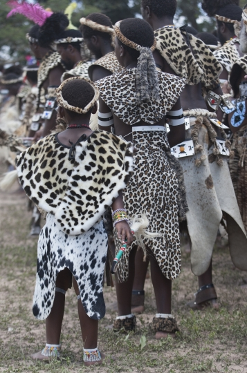 Young members of the Shembe Church wear fake leopard skins during their dance celebrations at eBuhleni, near Durban, South Africa, Sunday, Jan 29, 2017. At least 1,200 men in ceremonial attire have danced at a mainly Zulu gathering wearing a mix of hides of illegally hunted leopards and Chinese-made, spotted capes designed by conservationists to reduce demand for the real thing. (AP Photo/Khaya Ngwenya)