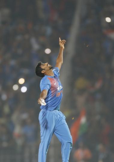 India's Jasprit Bumrah celebrates after winning their second Twenty20 international cricket match against England at Vidarbha cricket association stadium in Nagpur, India, Sunday, Jan 29, 2017. (AP Photo/Rajanish Kakade)
