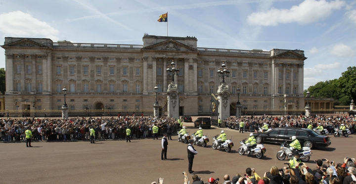 FILE - In this file photo dated Tuesday, May 24, 2011, The Royal Standard flag flies from above Buckingham Palace in London as the convoy carrying U.S. President Barack Obama arrives. The invitation to U.S. President Donald Trump for a state visit, one of the highest honors it can bestow on a visiting statesman where the queen acts as personal hostess with the traditional pomp and ceremony involved, has provoked a passionate debate, Tuesday Jan. 31, 2017. (AP Photo/Kirsty Wigglesworth, FILE)