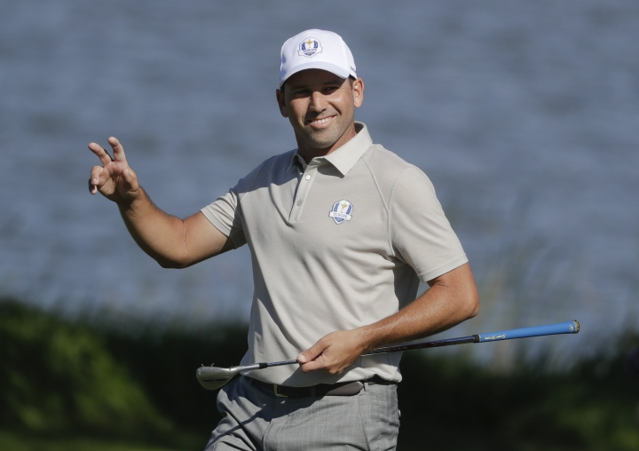 FILE- In this Saturday, Oct. 1, 2016 file photo, Spanish golfer Sergio Garcia reacts after making a birdie on the seventh hole during a four-ball match at the Ryder Cup golf tournament, at Hazeltine National Golf Club in Chaska, Minn. For more than 200 days, Garcia was the subject of a relentless Twitter campaign from one of his big fans. Mark Johnson, an Englishman, just wanted one thing: To be Garcia's caddie for a day. (AP Photo/Chris Carlson, File)
