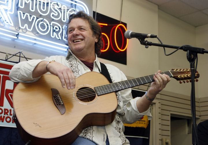 FILE - In this Thursday, April 17, 2008 file photo, John Wetton performs with the band Asia at a music store in New York. Singer and bassist John Wetton of the rock group Asia has died. He was 67. A statement from his publicist, Glass Onyon PR, says Wetton died Tuesday, Jan. 31, 2017 from colon cancer. (AP Photo/Jason DeCrow, file)