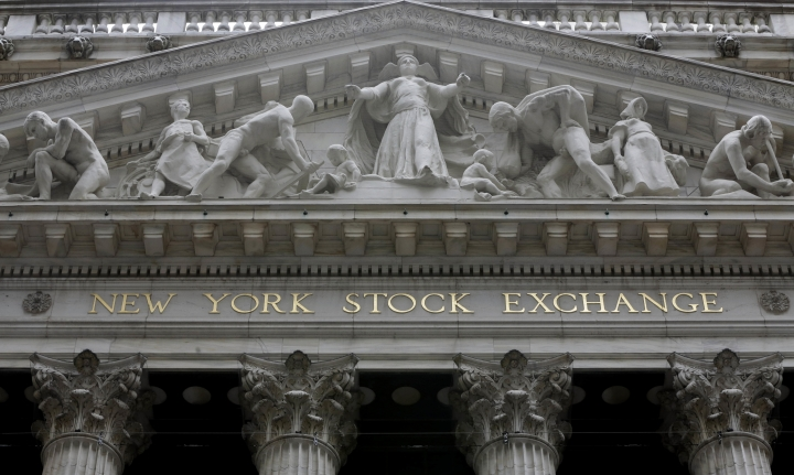 FILE - This Thursday, Oct. 2, 2014, file photo, shows the facade of the New York Stock Exchange. European stock markets eked out some modest gains Tuesday, Jan. 31, 2017, after encouraging economic figures boosted hopes that the region's recovery is gathering pace. (AP Photo/Richard Drew, File)