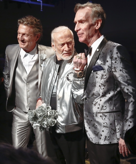 """Fashion designer Nick Graham, left, poses with his guest models, astronaut Buzz Aldrin, center, and Bill Nye, star of TV's """"Science Guy,"""" after unveiling his Mars-themed collection during men's Fashion Week, Tuesday, Jan. 31, 2017, in New York. (AP Photo/Bebeto Matthews)"""