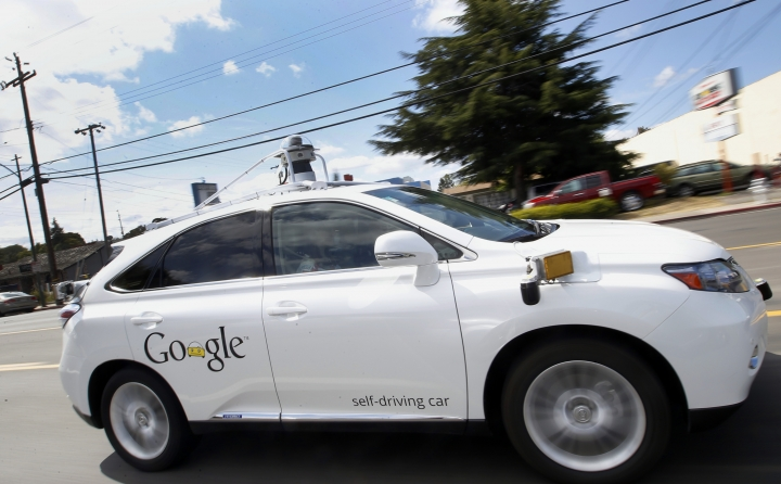 """FILE - In this May 13, 2015, file photo, Google's self-driving Lexus car drives along street during a demonstration at Google campus in Mountain View, Calif. California regulators release safety reports filed by 11 companies that have been testing self-driving car prototypes on public roads on Wednesday, Feb. 1, 2017. The papers report the number of times in 2016 that human backup drivers took control from the cars' self-driving software, though companies argue such """"disengagements"""" don't always reflect something going wrong. (AP Photo/Tony Avelar, File)"""