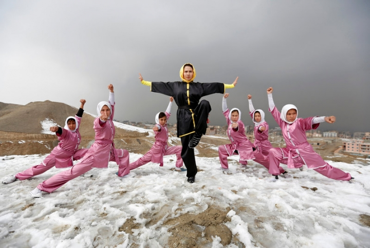 Sima Azimi (C), 20, a trainer at the Shaolin Wushu club, poses with her students after an exercise on a hilltop in Kabul, Afghanistan January 29, 2017. REUTERS/Mohammad Ismail