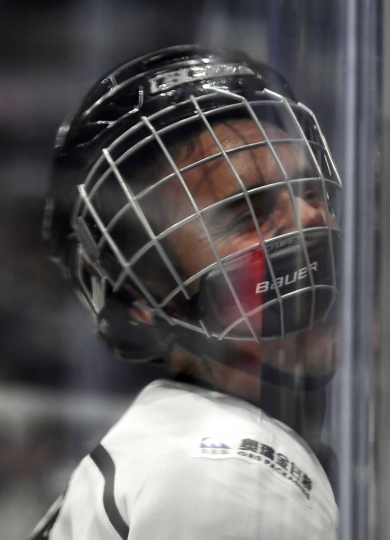 FILE - In this Jan. 28, 2017 file photo, singer Justin Bieber, who is playing for Team Gretzky, is pushed into the glass by Chris Pronger of Team Lemieux during the first period of the NHL All-Star Celebrity Shootout at Staples Center. Pronger, who works for the NHL's Department of Player Safety, joked that he fined himself $5 during a one-man hearing. Bieber was driven into the boards in the first half of a celebrity exhibition game by a laughing Pronger, who spent 18 years in the league as a hard-nosed defenseman. (AP Photo/Mark J. Terrill)