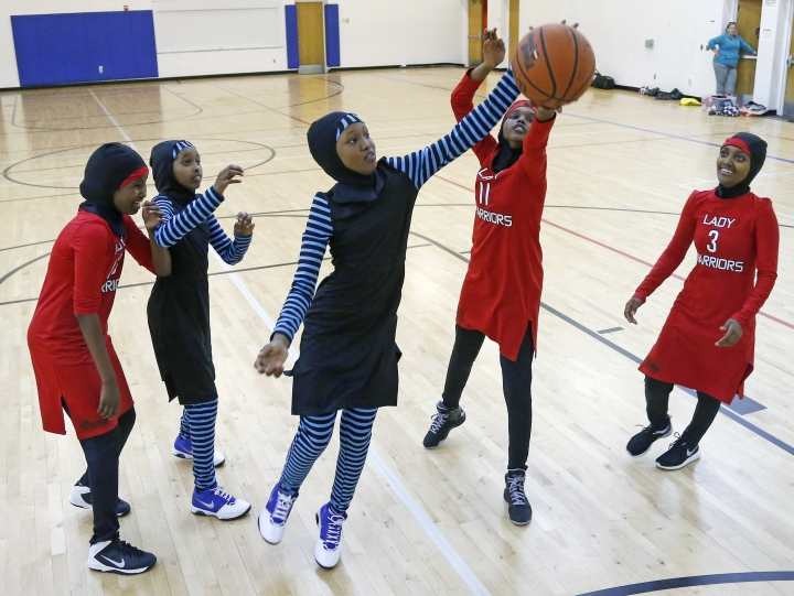 "FILE - In this June 16, 2015, file photo, East African Muslim girls practice basketball in their new uniforms in Minneapolis. International basketball competitions could have players wearing religious headgear including hijabs and yarmulkes soon. Leaders of basketball's governing body ""issued a mandate"" at their recent meeting for its playing rules committee to come forward with a proposal for headgear to be worn safely by athletes in competition, with the goal of approving the change at its meeting in May. FIBA announced the decision earlier this week. (AP Photo/Jim Mone, File)"