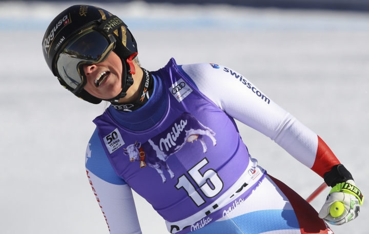 Switzerland's Lara Gut smiles in the finish area after completing an alpine ski, women's World Cup downhill race, in Cortina d'Ampezzo, Italy, Saturday, Jan. 28, 2017. (AP Photo/Alessandro Trovati)
