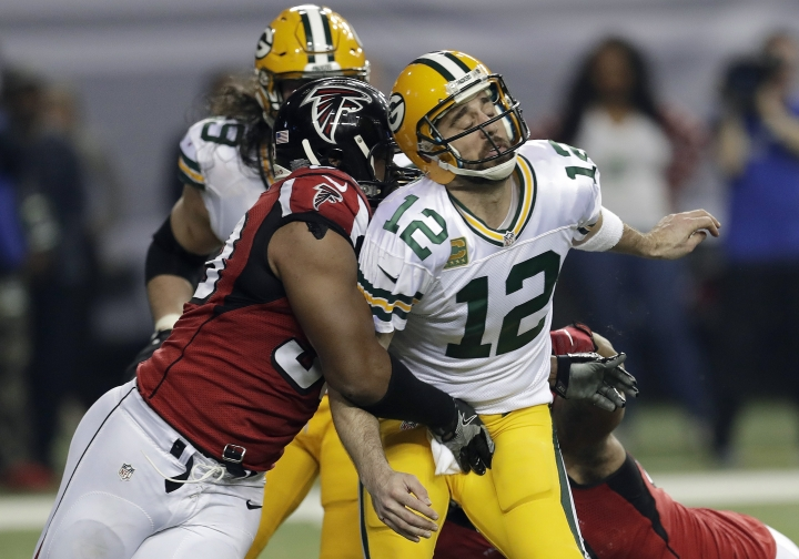 ADVANCE FOR WEEKEND EDITIONS, FEB. 4-5- FILE - In this Jan. 22, 2017, file photo, Atlanta Falcons defensive end Dwight Freeney (93) hits Green Bay Packers' Aaron Rodgers after throwing a pass during the second half of the NFL football NFC championship game in Atlanta. New England has a bunch of young players, 16 with four years or fewer in the NFL, and the Falcons actually have four guys who have played in a Super Bowl: Dwight Freeney, Courtney Upshaw, Dashon Goldson and Philip Wheeler. (AP Photo/David J. Phillip, File)