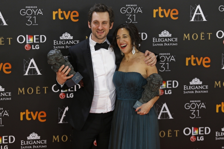 """Spanish actor and director Raul Arevalo, left, poses with his trophies for best new director and best film with producer Beatriz Bodegas for their roles in the movie """"Tarde para la ira"""" during the Goya Film Awards Ceremony in Madrid, Saturday, Feb. 4, 2017. The Goya Awards are Spain's main national annual film awards. (AP Photo/Francisco Seco)"""