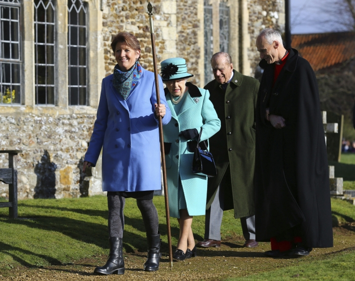Britain's Queen Elizabeth II and her husband Duke of Edinburgh, centre, arrive at St Peter and St Paul at West Newton, England, Sunday Feb. 5, 2017. The Queen is to make history on Monday Feb. 6, when she becomes the first British monarch to reach the Sapphire Jubilee, marking the 65th. anniversary of her accession to the throne. (Gareth Fuller/PA via AP)