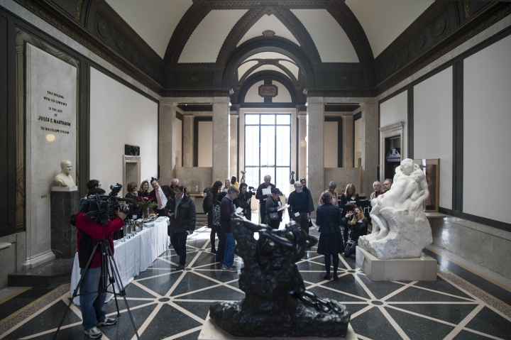 "In this Wednesday, Feb. 1, 2017, photo, members of the media view a copy of Rodin's ""The Kiss"" at the Rodin Museum in Philadelphia. The museum is celebrating the 100th anniversary of the sculptor's death with the new installation, named after his iconic sculpture of two lovers in a passionate embrace. (AP Photo/Matt Rourke)"