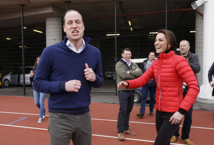 Britain's Prince William, foreground, reacts, with Kate, the Duchess of Cambridge, after running in a relay race, during a training event to promote the charity Heads Together, at the Queen Elizabeth II Park in London, Sunday, Feb. 5, 2017. (AP Photo/Alastair Grant, Pool)