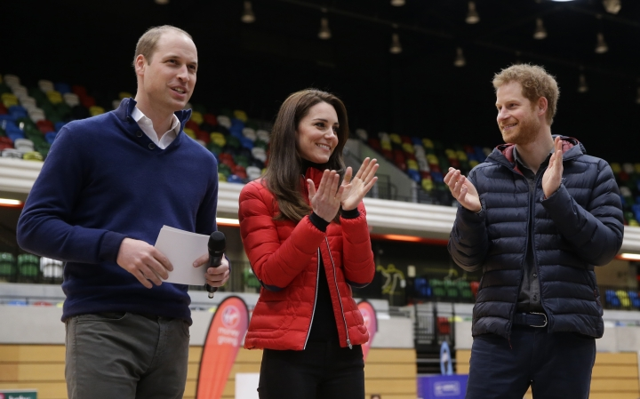 Kate, the Duchess of Cambridge, centre and Prince Harry, right, applaud Prince William after he spoke, during a training event to promote the charity Heads Together, at the Queen Elizabeth II Park in London, Sunday, Feb. 5, 2017. (AP Photo/Alastair Grant, Pool)