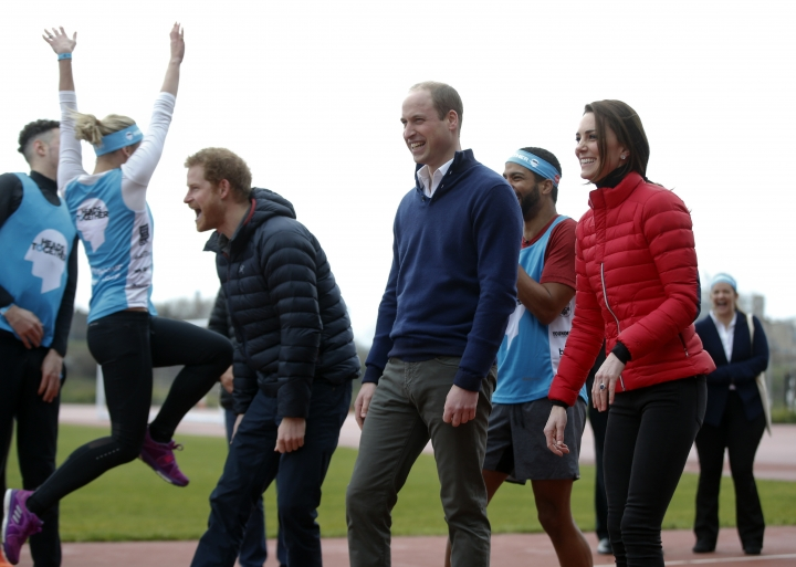 Britain's Prince William, centre, Kate, the Duchess of Cambridge, right, and Prince Harry react as they take part in a relay race, during a training event to promote the charity Heads Together, at the Queen Elizabeth II Park in London, Sunday, Feb. 5, 2017. (AP Photo/Alastair Grant, Pool)