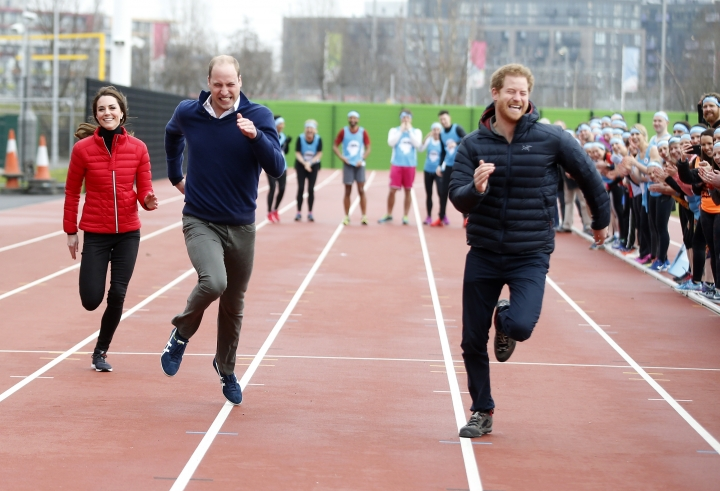 Britain's Prince William, second left, Kate, the Duchess of Cambridge, left, and Prince Harry take part in a relay race, during a training event to promote the charity Heads Together, at the Queen Elizabeth II Park in London, Sunday, Feb. 5, 2017. (AP Photo/Alastair Grant, Pool)