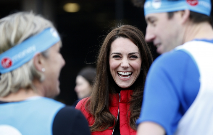 Britain's Kate, the Duchess of Cambridge, laughs as she prepares to take part in a relay race during a training event to promote the charity Heads Together, at the Queen Elizabeth II Park in London, Sunday, Feb. 5, 2017. (AP Photo/Alastair Grant, Pool)