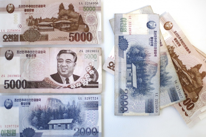 A portrait of the late Kim Il Sung is seen on the 5,000 bill of the North Korean won, Monday, Feb. 6, 2017. While foreign brand-name goods are often paid for in U.S. dollars, Euros or Chinese yuan, and priced accordingly at the official exchange rate, most people buy their daily necessities in North Korea's own currency, the won, which has an unofficial and more market-friendly exchange rate. (AP Photo/Wong Maye-E)