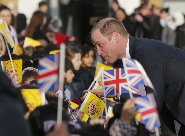 "Britain's Prince William speaks to pupils as he and Kate, The Duchess of Cambridge, arrive to attend ""The Big Assembly"" by Place2Be hosted at Mitchell Brook Primary School in London, Monday, Feb. 6, 2017. The Big Assembly, on the theme of kindness, is one of many being held at primary schools across the UK to mark Children's Mental Health Week (Feb. 6-12). (AP Photo/Frank Augstein)"