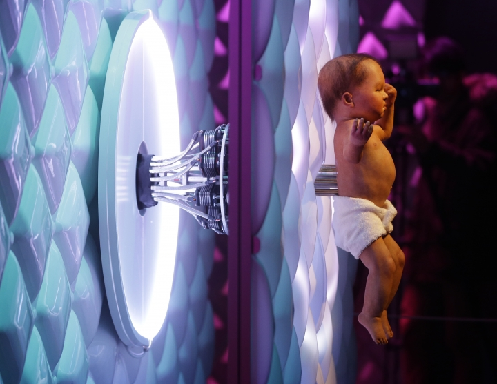 Animatronic baby London 2016, a mechanical human baby with an electronic umbilical cord is displayed, during a press preview for the Robot exhibition held at the Science Museum in London, Tuesday, Feb. 7, 2017. The exhibition which shows 500 years of mechanical and robotic advances is open to the public form Feb. 8 through to Sept. 3. (AP Photo/Alastair Grant)