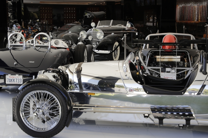 This Thursday, Jan. 26, 2017, photo shows classic cars valued over $30 million in the garage area of a $250 million mansion in the Bel-Air area of Los Angeles. The mansion, the most expensive home listed in the U.S., includes 12 bedroom suites, 21 bathrooms, five bars, three gourmet kitchens, a spa and an 85-foot infinity swimming pool with stunning views of Los Angeles. (AP Photo/Jae C. Hong)