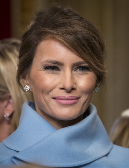 "FILE - In this Jan. 20, 2017, file photo, first lady Melania Trump leaves the President's Room of the Senate on Capitol Hill in Washington after President Donald Trump signed his first legislation. First lady Melania Trump expected to develop ""multi-million dollar business relationships"" tied to her presence in the White House, according to a lawsuit she filed. And she has yet to step away from the companies that manage royalties from her name-branded products, business documents show. (AP Photo/J. Scott Applewhite, Pool)"