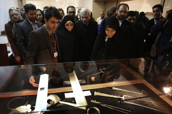 In this photo taken on Monday, Feb. 6, 2017, chief of Iran's Cultural Heritage, Handicrafts and Tourism Organization Zahra Ahmadipour, right, and Special Assistant to the Iranian President on Citizenship Rights Elham Aminzadeh, center left, look at artifacts during the opening of a show displaying some 550 ancient Persian artworks returned by Western countries, including the United States, at Iran National Museum in Tehran, Iran. (AP Photo/Vahid Salemi)