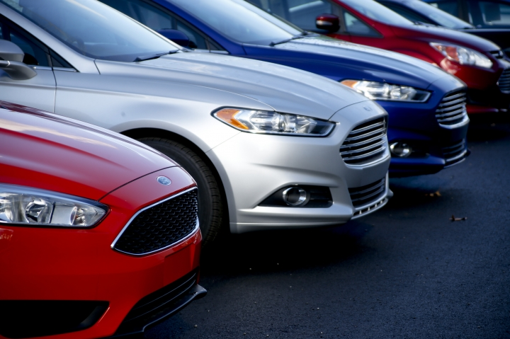 FILE - In this Thursday, Nov. 19, 2015, file photo, a row of new Ford Fusions are for sale on the lot at Butler County Ford in Butler, Pa. Ford Motor Co. has built the midsize Fusion sedan at its plant in Hermosillo, Mexico, since its introduction in 2005. (AP Photo/Keith Srakocic, File)