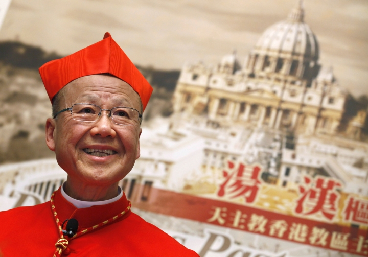 "FILE - In this March 2, 2012 file photo, newly-selected Cardinal John Tong speaks to the media in Hong Kong. The head of the Catholic church in Hong Kong has expressed optimism that the Vatican and Beijing can overcome the controversial issue of bishop appointments lying at the core of a decades-long dispute. Tong said in a lengthy essay published by the Hong Kong diocese that a ""preliminary consensus has reportedly been reached"" on the matter, and suggested that the pope could retain veto power over the ordination of mainland bishops under the new arrangement.(AP Photo/Kin Cheung, File)"