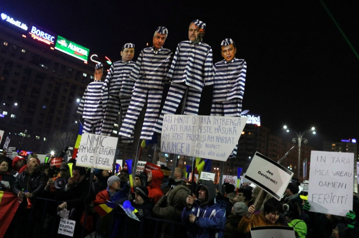 FILE PHOTO: Protesters hold effigies with the faces of leader of Romania's leftist Social Democrat Party (PSD) Liviu Dragnea and other members of the party dressed as prisoners, during a demonstration in Bucharest, Romania, February 3, 2017. REUTERS/Stoyan Nenov/File Photo