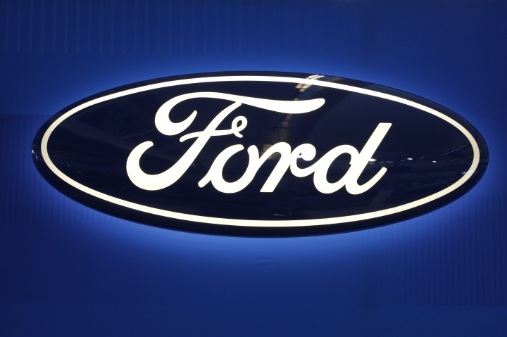 FILE - This Feb. 11, 2016, file photo shows the Ford logo on display at the Pittsburgh International Auto Show in Pittsburgh. Ford Motor will spend $1 billion to take over a robotics startup to acquire more of the expertise needed to reach its ambitious goal of having a fully driverless vehicle on the road by 2021. The big bet announced Friday, Feb. 10, 2017, comes just a few months after the Pittsburgh startup, Argo AI, was created by two alumni of Carnegie Mellon University's robotics program, Bryan Salesky and Peter Rander.(AP Photo/Gene J. Puskar, File)